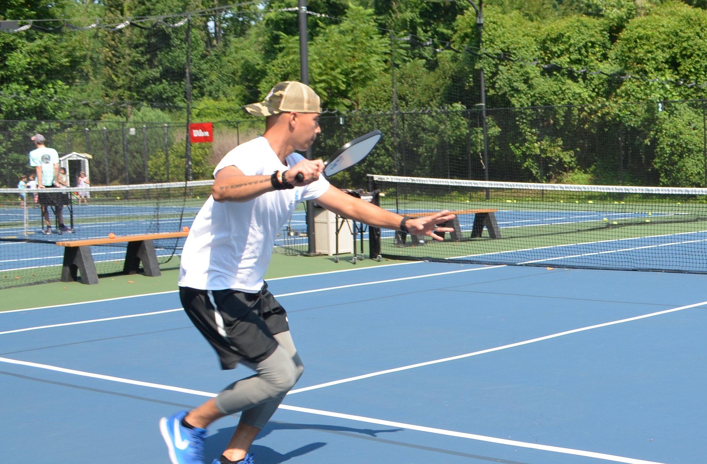 Alex swinging racquet closeup-1